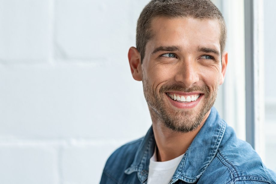 man with short hair and beard smiling